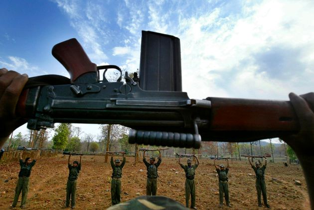 Maoist rebels or Naxalites in a file