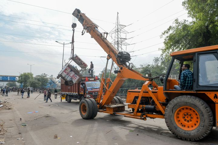 A crane is used to clean the streets in Shaheen Bagh area after protesters were removed on March 24, 2020.