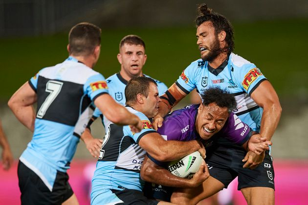 Felise Kaufusi of the Storm is tackled during the round 2 NRL match between the Cronulla Sharks and the...