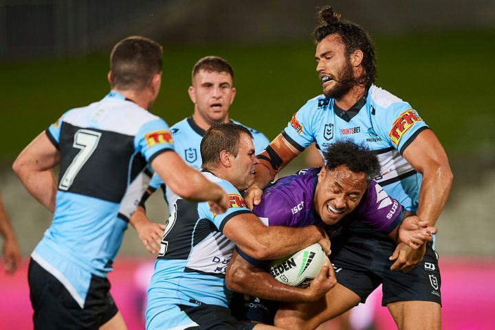 Felise Kaufusi of the Storm is tackled during the round 2 NRL match between the Cronulla Sharks and the Melbourne Storm at Netstrata Jubilee Stadium on March 21, 2020 in Sydney, Australia.
