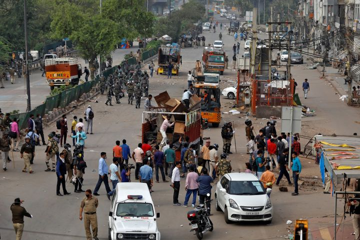 Police clear the site of protest in Shaheen Bagh area of New Delhi, March 24, 2020.