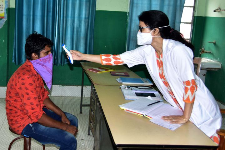 NAGAON,INDIA-MARCH 22,2020: A Doctor use thermal screening devices on youth who return from Kerela state in the wake of deadly coronavirus at Civil Hospital in Nagaon district of Assam,India - PHOTOGRAPH BY Anuwar Ali Hazarika / Barcroft Studios / Future Publishing (Photo credit should read Anuwar Ali Hazarika/Barcroft Media via Getty Images)