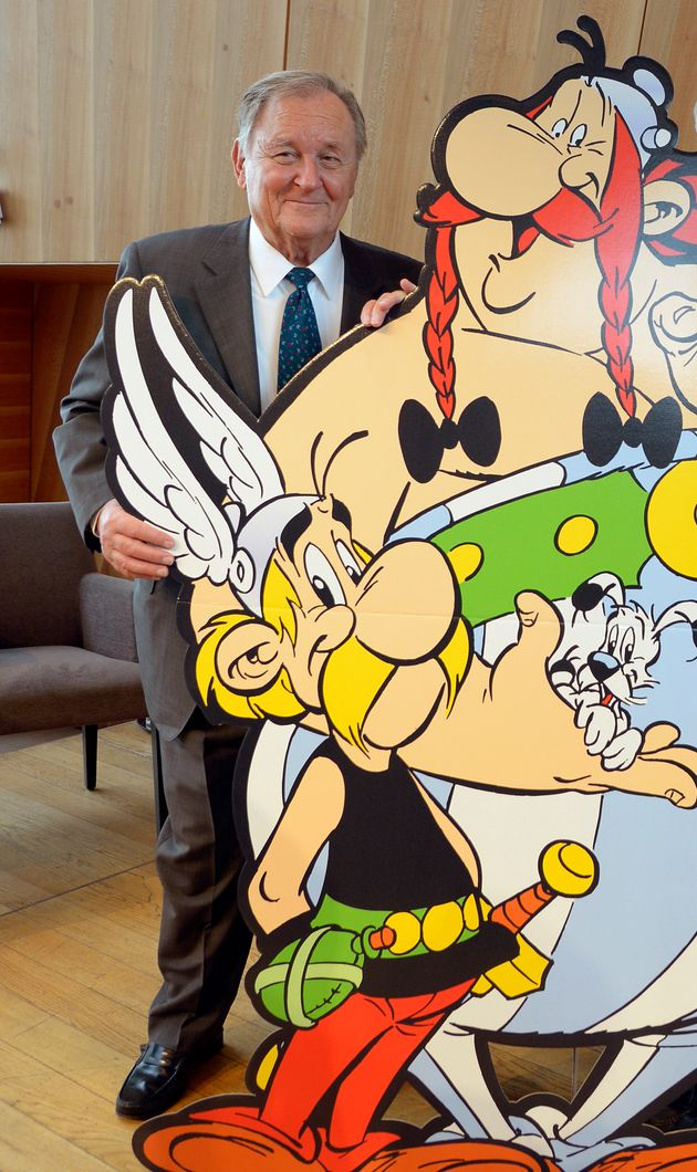 French cartoonist and author Albert Uderzo poses next to a cardboard cut-out of Asterix and Obelix characters...