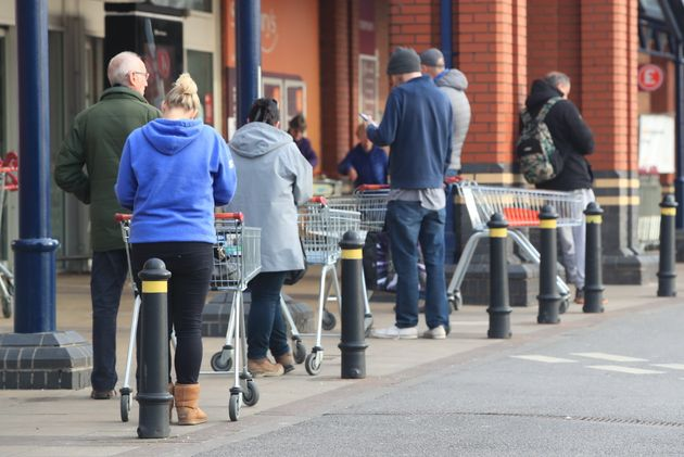 People queue at a Sainsbury's supermarket at Colton, on the outskirts of Leeds, the day after prime minister...