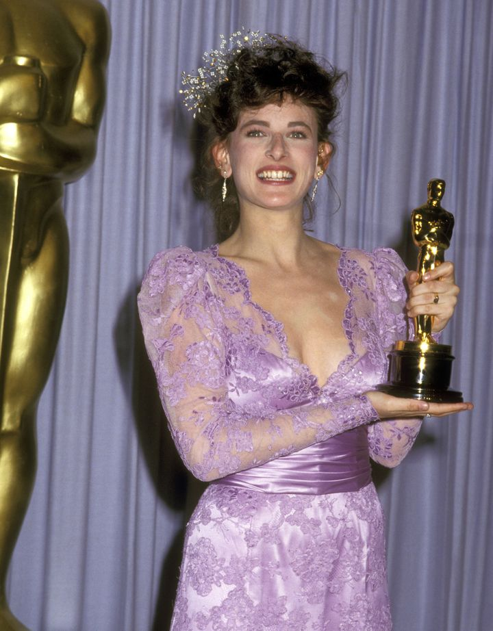 Marlee Matlin enjoys a historic night at the 1987 Oscars ceremony.
