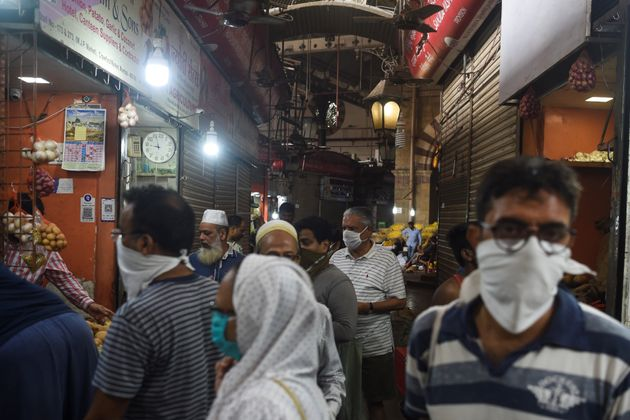 People shop in a Mumbai market on Tuesday, ahead of Modi's