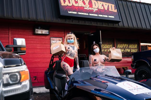 Axel and Poni Noel, two dancers at Lucky Devil Lounge. The staff there has come up with an inspired way...