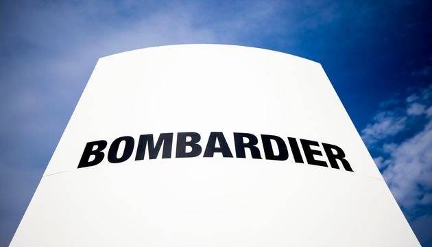 In this undated photo, the Bombardier logo is seen on an outdoor sign. The company is temporarily halting...