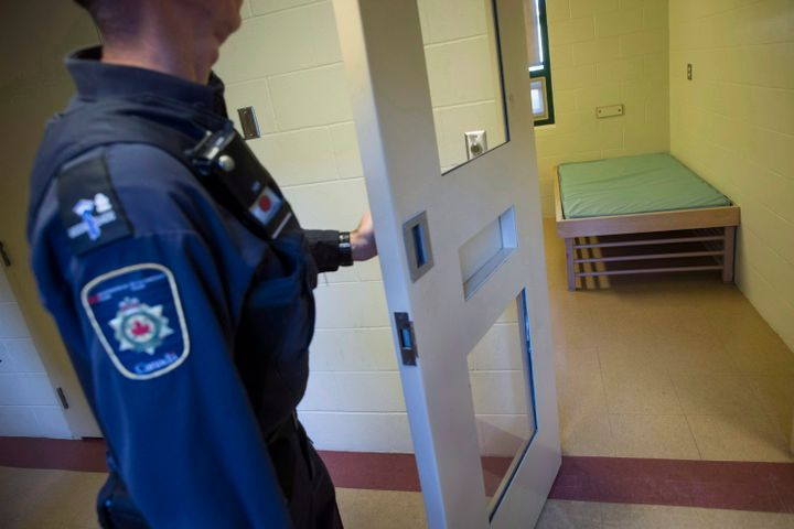 A correctional officer opens the door to a cell in the segregation unit at the Fraser Valley Institution for Women in Abbotsford, B.C. on  Oct. 26, 2017.