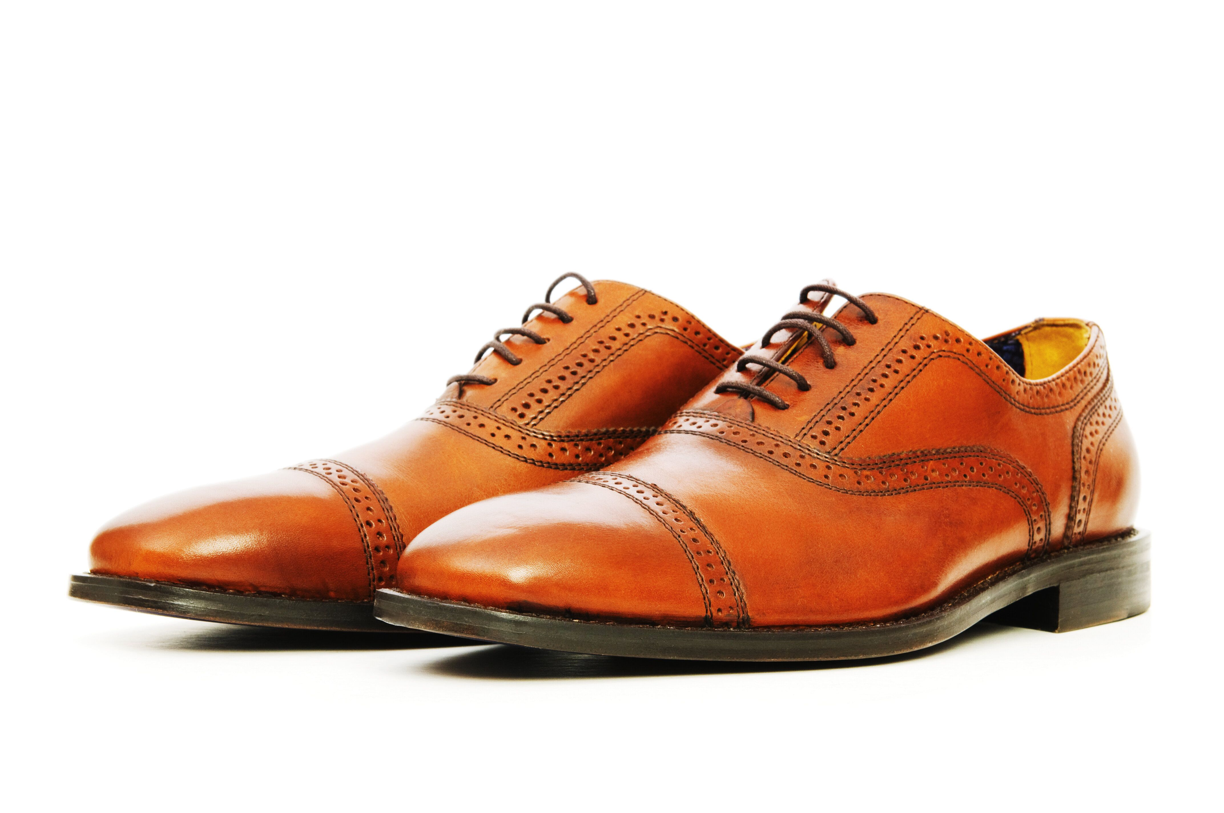 Avoid spraying leather shoes with Lysol -- it's one of the only surfaces that can't withstand the chemicals.