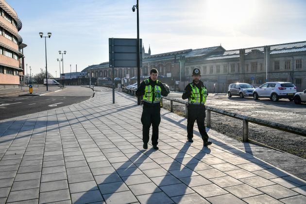 British Transport Police patrol the perimeter of Bristol Temple Meads train station, which is empty of rush-hour commuters and travelers at 8am the day after Prime Minister Boris Johnson put the UK in lockdown.
