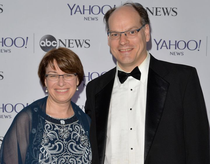Sen. Amy Klobuchar said her husband, John Bessler, remains hospitalized after contracting the coronavirus.