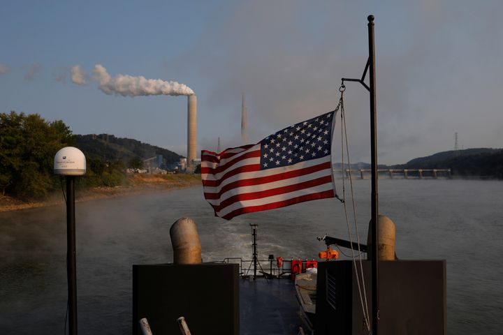 A boat passes the W. H. Sammis Power Plant, a coal-fired power plant owned by FirstEnergy, along the Ohio River in Stratton,