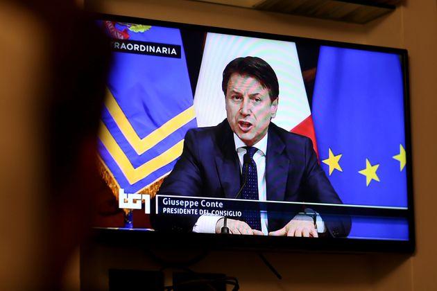 ROME, ITALY - MARCH 21: A man watches tv as Italian Prime Minister Giuseppe Conte announces the shut...