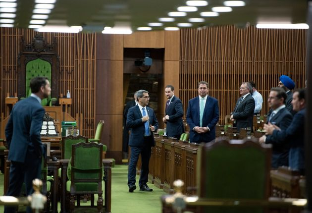 Conservative MPs, including leader Andrew Scheer, wait for the speaker's parade to arrive, as a limited...