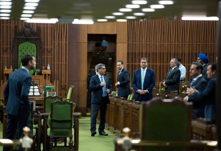 Conservative MPs, including leader Andrew Scheer, wait for the speaker's parade to arrive, as a limited number of MPs return to the house to discuss measures to respond to the COVID-19 outbreak, in Ottawa, on March 24, 2020.