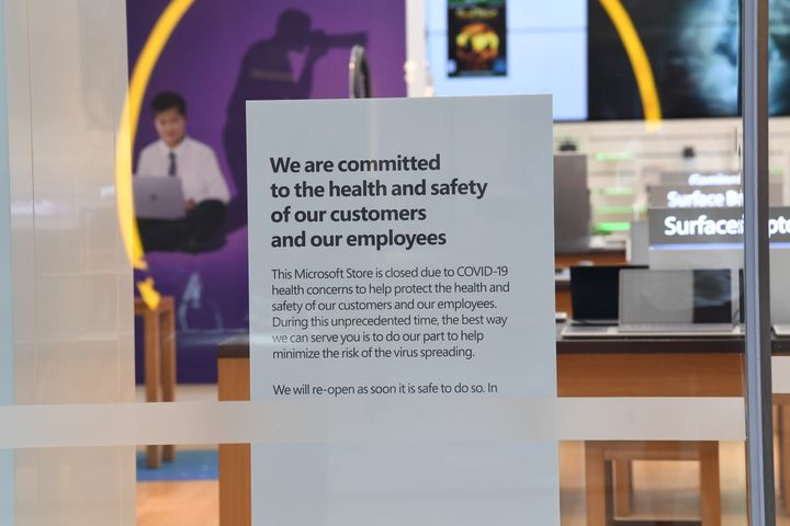 A sign informing customers that the Microsoft store is closed on Pitt Street mall on March 21, 2020 in Sydney, Australia.