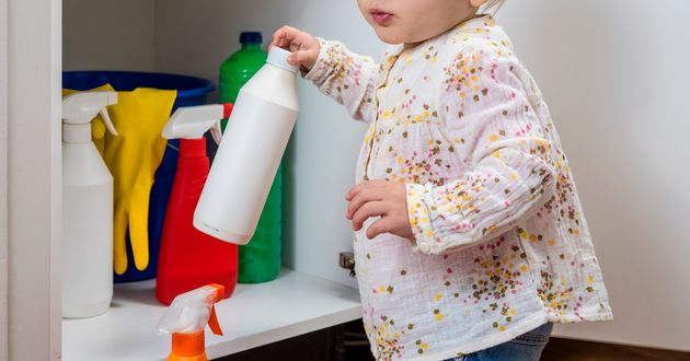 Toddler playing with household cleaners at
