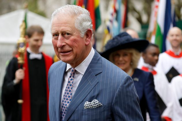 Prince Charles and Camilla the Duchess of Cornwall, in the background, leave after attending the annual...