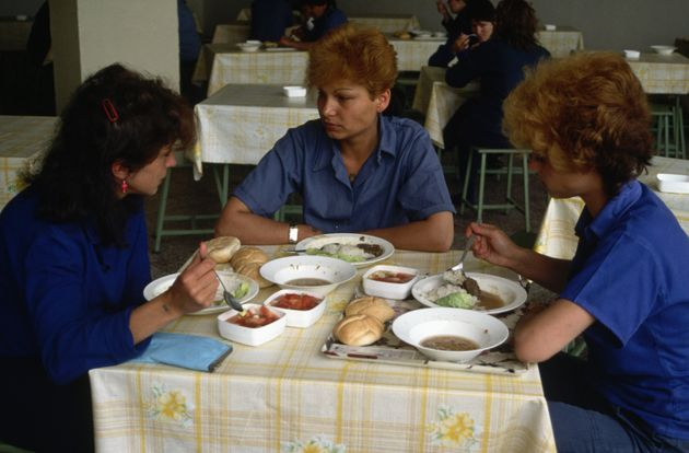Women prisoners eating a prison canteen