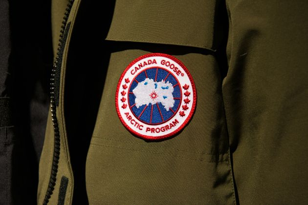The Canada Goose logo appears on a coat in New York in 2016. The company is best known for producing...