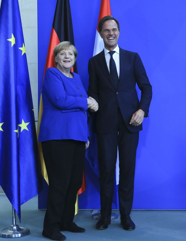 BERLIN, GERMANY - OCTOBER 02: German Chancellor Angela Merkel (L) and Dutch Prime Minister Mark Rutte...