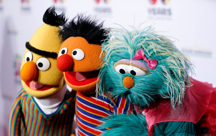 "Bert, Ernie, and Rosalita of ""Sesame Street"" pose for a photo."