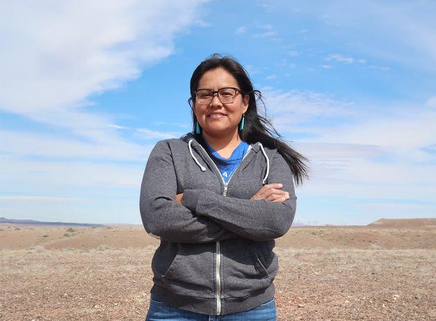 Shanna Yazzie stands in the desert near her