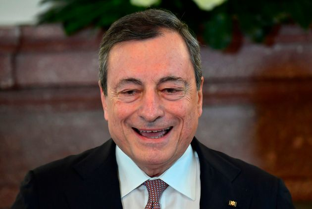 Italian economist Mario Draghi gives a speech after being awarded the Federal Cross of Merit during a...