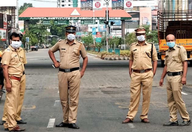 Police stand guard on a road in Kochi, Kerala, on March 25,