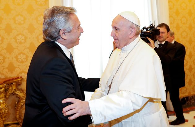 Pope Francis welcomes Argentina's President Alberto Fernández, left, during a private audience...