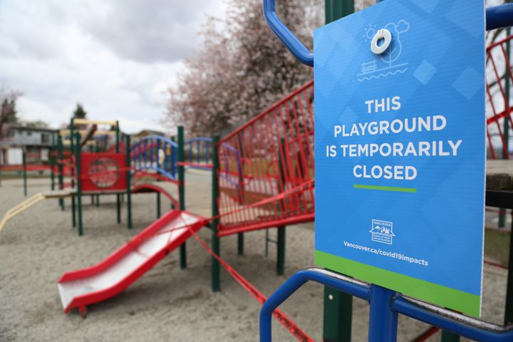 A sign shows that playground is closed at Falaise Park in Vancouver, Canada on March 23, 2020.