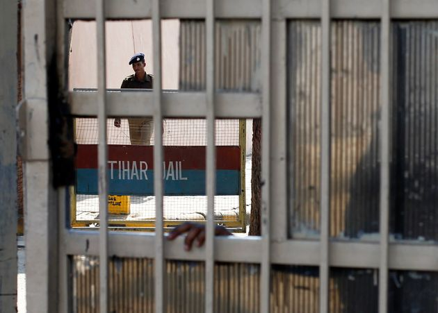 A policeman walks inside the Tihar Jail in New Delhi March 11,