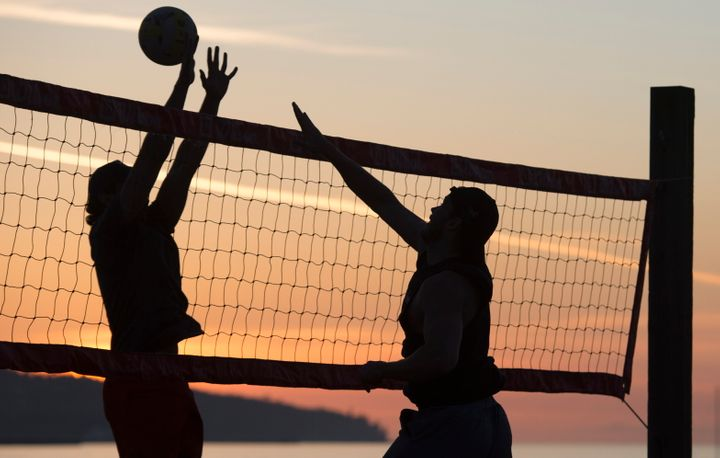People play volleyball on Kitsilano Beach in Vancouver, British Columbia, in spite of the province urging people to practice social distancing.