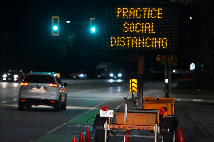"""A highway sign reminding people about """"social distancing"""" in the midst of the COVID-19 coronavirus outbreak."""