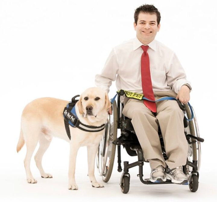 Ryan Honick and his service dog, Pico. Social distancing measures can make basic tasks, such as grocery shopping, more diffic