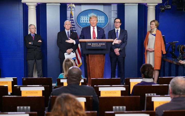 President Donald Trump is joined by (from right) White House Coronavirus Task Force coordinator Deborah Birx, U.S. Treasury S