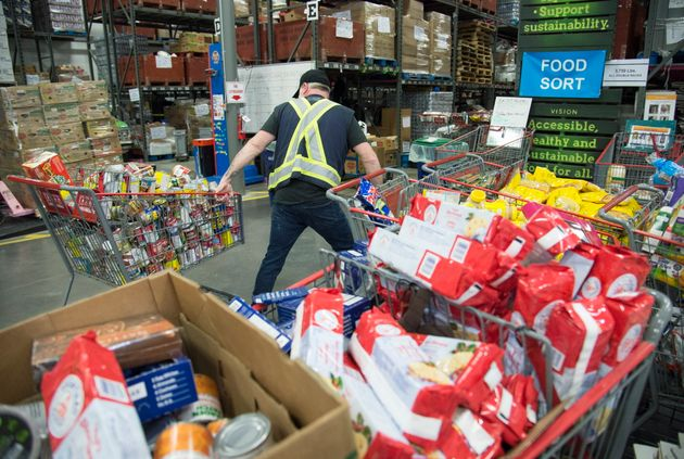 Staff at the Greater Vancouver Food Bank prepare food in Burnaby, British Columbia on March 18,