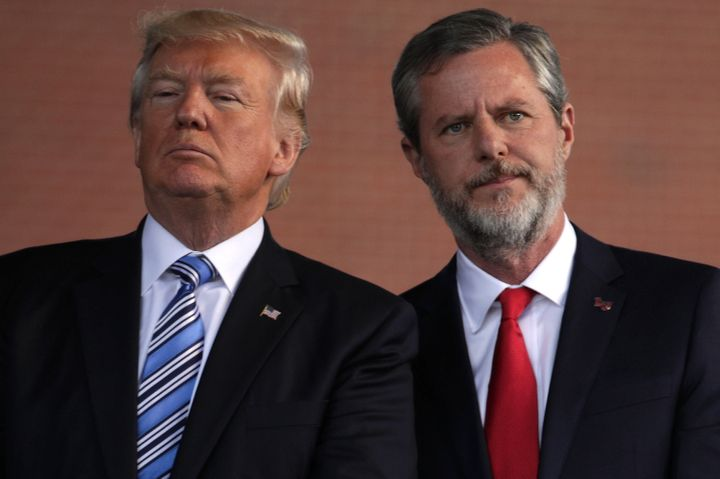 U.S. President Donald Trump (left) and Jerry Falwell (right), president of Liberty University, on stage during a commencement
