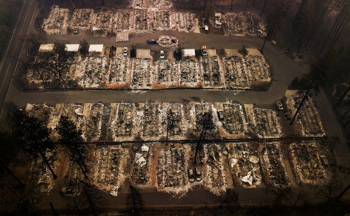 An aerial file photo taken in 2018 shows the remains of residences leveled by the Camp Fire in Paradise, Calif.