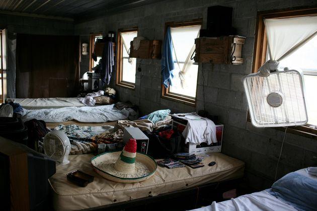 A migrant farmworkers' dorm room in central North Carolina. (Photo by Andrew Lichtenstein/Corbis via...