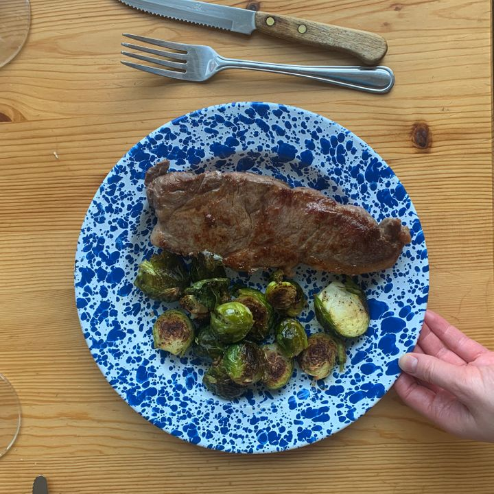 """A steak and roasted Brussels sprouts Slone's boyfriend made. """"He works in fine dining, so frozen chicken nuggets probably won't cut it,"""" she said."""