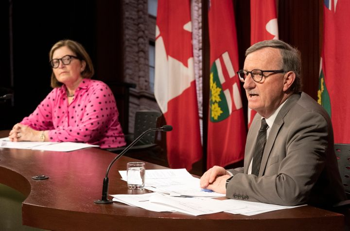 Toronto Medical Officer of Health Dr. Barbara Yaffe (left) listens as Ontario Chief Medical Officer of Health Dr. David Williams speaks at Queen's Park in Toronto on March 25, 2020.
