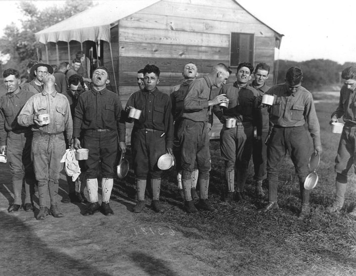 Men gargle with salt and water as a preventive measure against the influenza epidemic at Camp Dix, New Jersey, in September 1