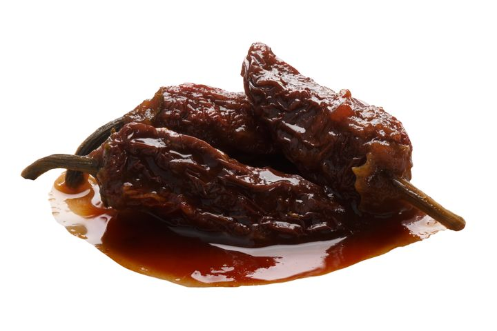 Chipotles in adobo are whole smoke-dried jalapeno peppers in seasoning.