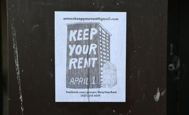 A poster in Toronto on March 24. With many not working there is a groundswell for free rent in April...
