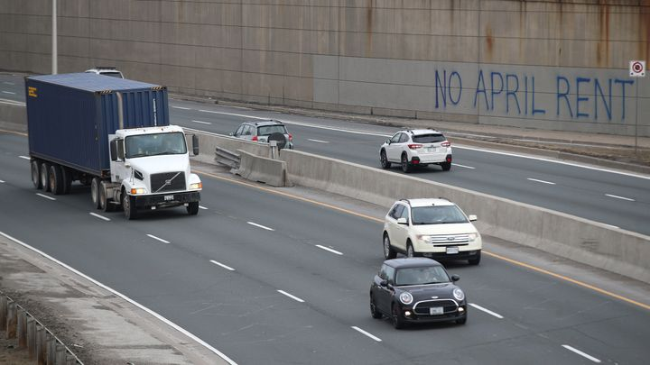 No April Rent reads new graffiti along the Gardiner Expressway leading into the Toronto on March 24.