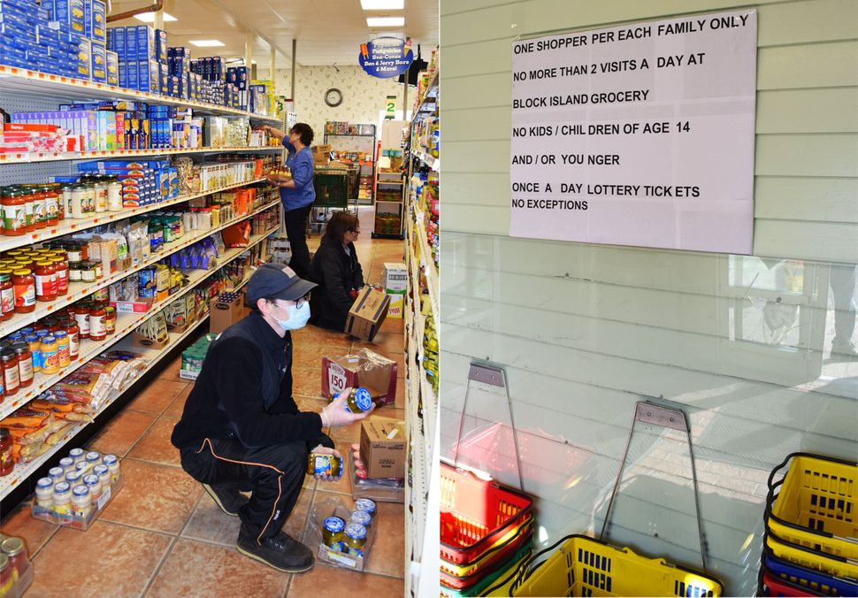 Workers stock shelves at Block Island's only year-round grocery store on March 26. Posted rules limit the number of visits pe