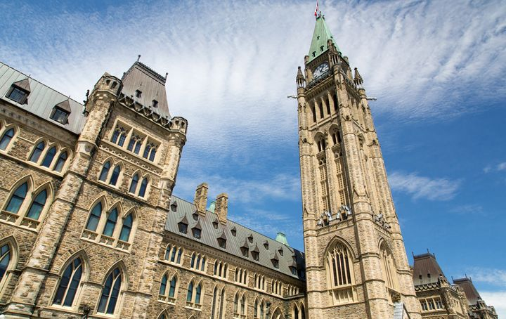 In this stock photo, the spires of the central block of Parliament in Ottawa are seen on a sunny day. Stimulus spending in response to the novel coronavirus pandemic may not do much to fire up the economy, the PBO noted.