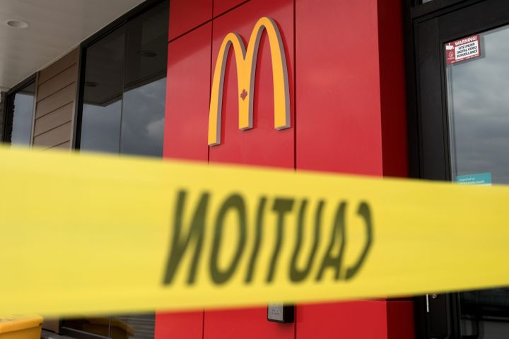 A McDonald's restaurant with caution tape around it is seen here Tuesday in Kingston, Ont. An 18-year-old woman is facing multiple charges after another McDonald's in the province had to close over COVID-19 concerns.